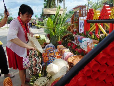 Dr. Luz Taposok visits the exhibit of different cultural, agriculture and tourism products of Davao del Norte during its 50th Founding Anniversary held in the Sports and Tourism Complex.