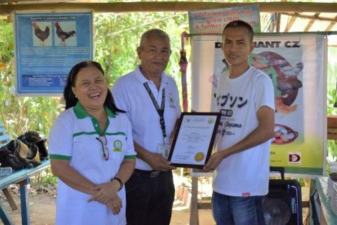 Shirley Beldia, Abdul Daya-an, Edwin Fetalino group photo on certification turn-over