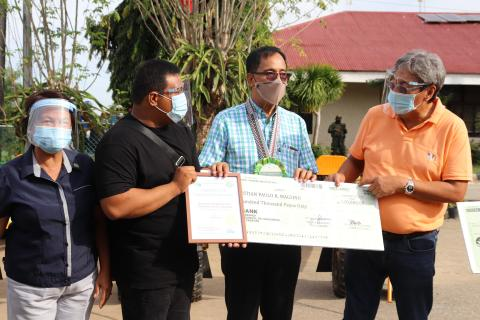 Agriculture Secretary William Dar together with Isabela Governor Roditro Albano and ATI RTC 2 Center Director Imelda Guillermo awards support to BH Roque Integrated Farm oF Santiago City