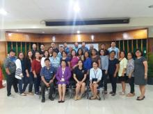 A photo opportunity with Dr. Luz A. Taposok (Center), ATI Director during the national updates on the DA's Disaster Risk Reduction Policy Actions in Agriculture and Fishery Extension (AFE) cum ATI Climate Resilient Agriculture Project Progress Reporting.