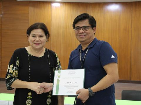 Dr. Bautista shakes hand with CD Barrientos of ATI Mimaropa