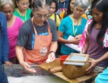 Owner/Manager of Papyrus Arts and Craft Mrs. Cristina G. Lachica teaches the participants how to make hand-made paper.