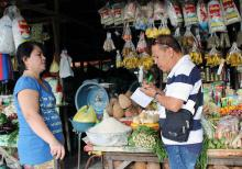 An AEW conducts a market survey at Pototan Public Market as part of the training.
