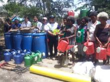 Sec. Manny F. Piñol together with DA-RFO6 Reg'l Executive Director Remelyn R. Recoter, ATI-RTC VI Center Director Eden DLR. Bautista,  Hon. Soviet Dela Cruz and other DA attched represenatives award various vegetable seeds and garden tools to start-up their communal garden.