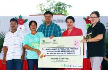 ATI OIC National Director Dr. Luz Taposok awards livelihood kits to CRA farmers during the launching program of the Climate Resilient Agriculture (CRA) Project.