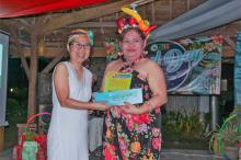 ATI-RTC 8 Center Director Hazel Grace Taganas hands over the Management's Choice Award to Ms. Vanjing Seco during the 2019 Excel Day
