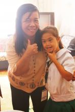 Center Director Alicia Rose D. Nebreja and Zyann L. Abapo, 4-H Special Learners' Club member with down syndrome, flash their sweetest smiles before the camera during the meet and greet activity.