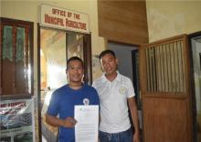 Mr. Jason B. Deripaz, AgriDOC Graduate from Margosatubig with the Project Officer, Mr. Nino O. Codino.