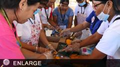 Participants while processing the mango