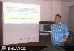 Planning Officer II Philip D. Villegas delivers a powerpoint presentation during the meeting with the LGU representatives.
