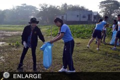 Dr. Taposok and community police officers during clean-up drive in Laguna de Bay.