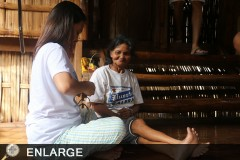 Jean Eguilos of ATI 4B taught by Nanay Lucia of the Iraya-Mangyan Tribe on handicraft making. Photo by: Rose Ann Nilo