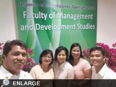 Four of our graduates, together with their course coordinator, pose with triumphant smiles. Photo by: Rolando Maningas
