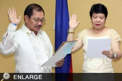 Dr. Luz Taposok takes her oath of office with DA Secretary Emmanuel Piñol.