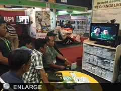 A group of farmers from Tanuan City, Batangas closely watches the Organic Agriculture TeleMagazine of ATI