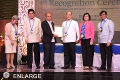 Deputy Director Aton receives the award for ATI at GQMC's 4th Recognition Ceremony